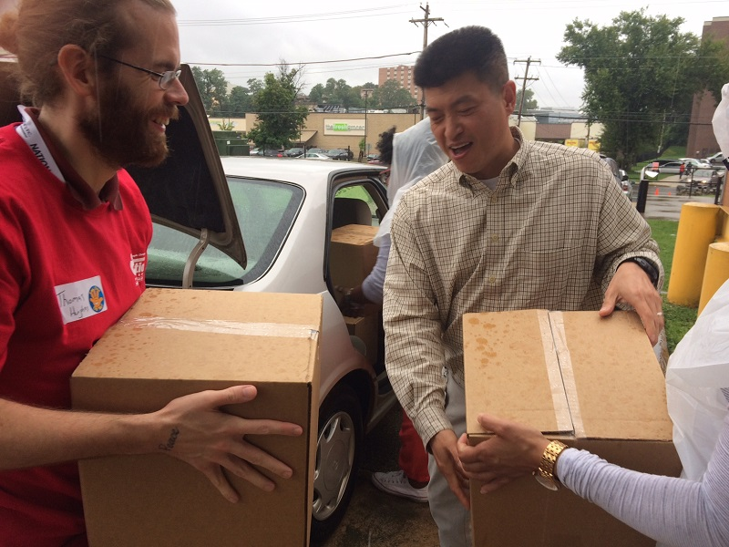 Early Intervention - Molina Foundation volunteers Thomas Hughes (left), Adrienne Ailen (right) and Heather Lewis (back) help SEEDS Director for Compliance Don Lee load donated books for delivery to SEEDS.